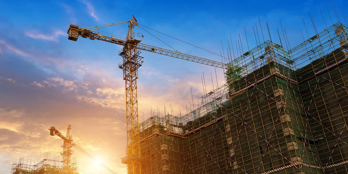 35771666 - construction site Schlagwort(e): architect, architecture, base, blue, built, collar, concrete, construction, crane, developing, development, estate, flare, force, frame, framework, group, helmet, high, hook, housing, industry, laborer, labourer, manual, mega, megacrane, men, occupation, people, profession, property, real, scaffolding, scene, site, structure, sun, sunset, teamwork, under, work, worker, workforce